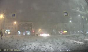 Pedestrian Rolls over Snowy Road