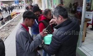 Footage shows local Tijuana shop owner serving food to Honduran migrants