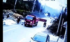 Family on scooter taken out by back door on lorry trailer