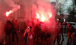 Flares and fire as Ukrainians protest outside Russian consulate in Kharkiv