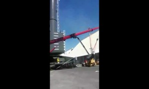 Men left hanging metres in the air after crane falls in freak accident