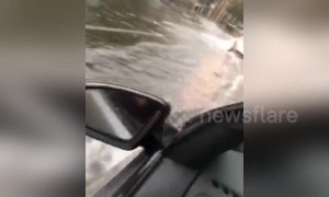 Cars drive on flooded roads as torrential rain lashes Sydney
