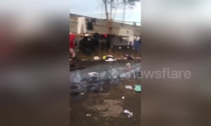 Footage shows conditions of shower area at migrant shelter by US-Mexico border