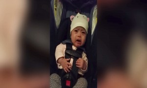 Baby gets Expressive when she hears the National Anthem