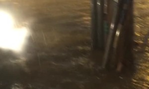 Guy on Scooter Face Plants Into Flood Water