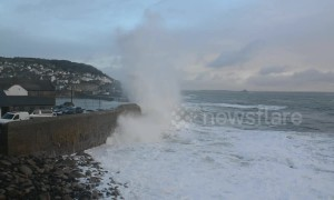 Huge Storm Diana waves surge over Mousehole Harbour wall in Cornwall