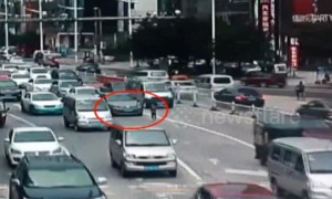Girl falls out of three-wheeler onto busy road