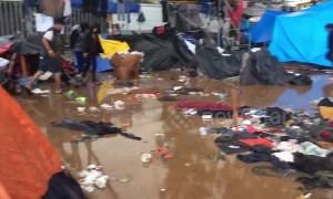 Tijuana migrant shelter a muddy mess as rain pours down