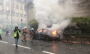 "Firefighters extinguish blazing car during Paris ""yellow vests"" protest"