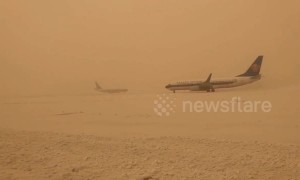 Dust storms blanket China's northwest in 'yellow snow'