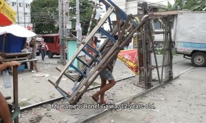 Manila 'trolley boys' use handmade carts to ferry commuters on illegal railway
