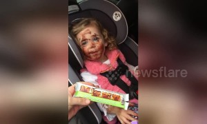 Naughty 3-year-old paints her face with chocolate while waiting in the car
