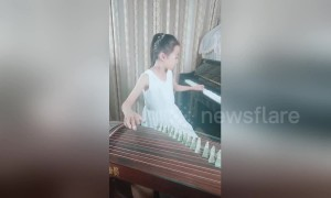 Talented Chinese girl plays piano and Chinese string instrument simultaneously