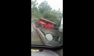 At least 25 injured as bus skids off bridge in the Philippines