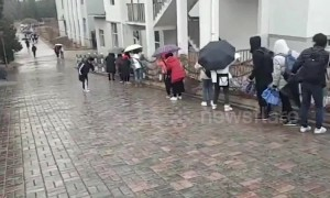 Chinese university students slip on icy ramp road following rainfalls