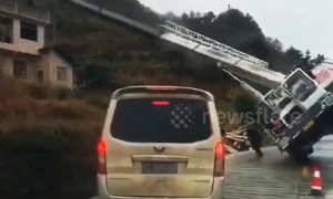 Two men narrowly escape being buried by crane falling over on road