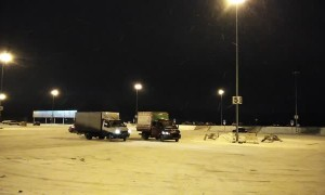 Trucks Drift For Fun in Snowy Lot