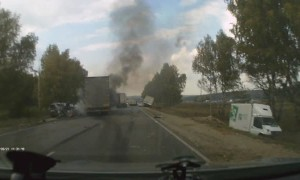 Vehicle Accident Creates Flames on Russian Roadway