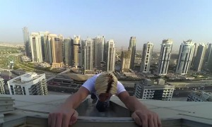 Man Performs Some High-Rise Stunts