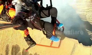 Woman makes daring flight across volcanic crater using motorcycle-powered paraglider