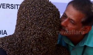 Indian man wins world record for wearing 60,000 bees on his face for four hours