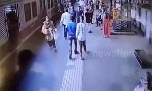 Two brave cops save women from slipping under moving train in Mumbai