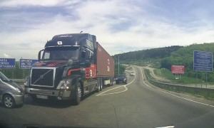 Transport truck stops at the very last second to avoid collision