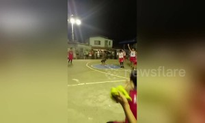Basketball referee does cartwheels and splits when a player scores
