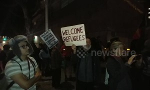 Activists stage rally in downtown LA to support asylum seekers on International Human Rights Day