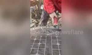 Skilful man uses angle grinder to carve gorgeous art onto stone slab