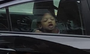 Girl Licks Window and Makes Silly Faces