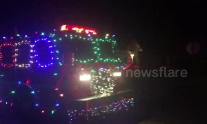 Santa in Arkansas shows up on his firetruck sleigh with his firefighter elves