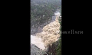 Waterfall turned into cascading rush of water as torrential rain lashes Australian state of Victoria