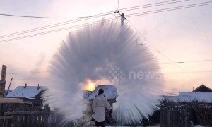 Woman makes amazing ice halo in the air with boiling water
