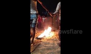 Man pours kerosene on line of fire before walking barefoot over it