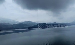 Incredible waterspout spotted over reservoir in southern China