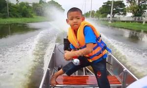 Bangkok schoolboy beats traffic by piloting motorboat to school