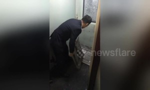 Train door in China freezes solid and has to be broken out by staff