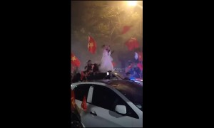 Football superfan wears wedding dress to celebrate Vietnam team win