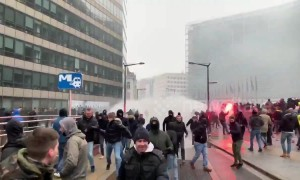 Belgian police fire water cannon at anti-migrant protesters