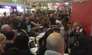 Travellers mob service desk only to be told all flights are cancelled