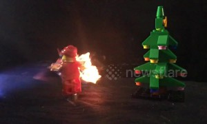 Spinning Lego Santa Claus gets set on fire with blow torch in slow motion