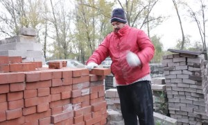 Man Breaks Bricks By Hand