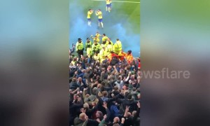 Chaos at Villa Park as Leeds grab late winner with flares thrown on the pitch and fans piling towards players