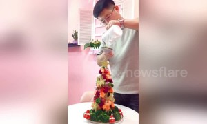Romantic husband makes edible fruity Christmas tree for his wife