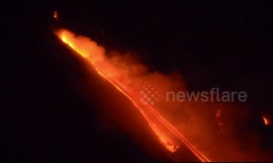 Footage shows smoke and lava flows from erupting Mt Etna