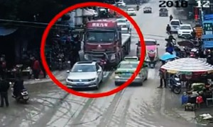 Two pedestrians narrowly escape death after being knocked down by lorry