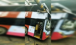 Passenger killed when double-decker bus crashes into height barriers