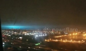 View from flight shows eerie blue grow lighting up New York City sky after transformer explosion
