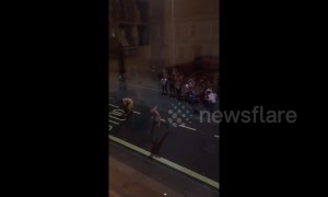 "Hilarious! UK students cheer as road painter finishes the last letter of ""Bus Stop"""